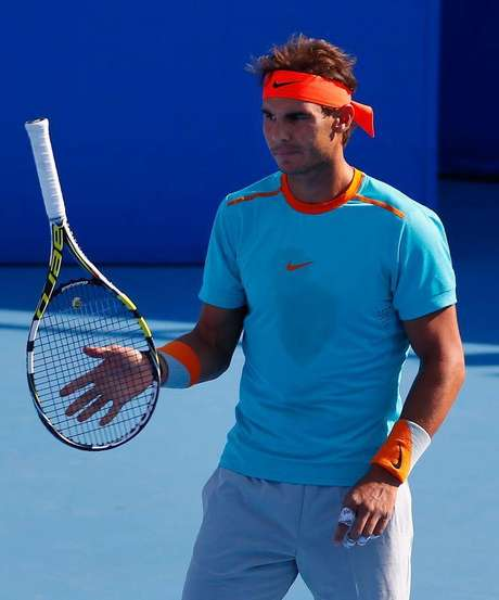 Tenista espanhol Rafael Nadal durante partida de duplas no Aberto da China, em Pequim. 29/09/2014