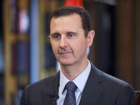 <p>O presidente da Síria, Bashar al-Assad, fala durante entrevista à televisão estatal venezuelana TeleSUR em Damasco, em fotografia distribuída pela agência de notícias SANA, em 26 de setembro de 2014</p>