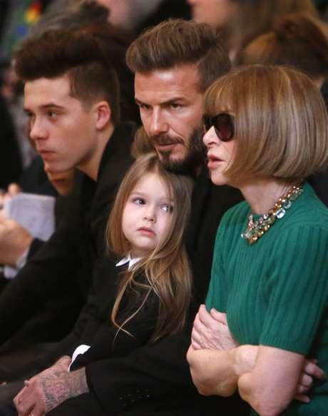 A editora de moda Anna Wintour sentou-se ao lado de David