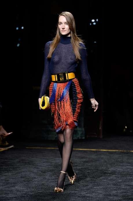 Na apresentação da Balmain em Paris, blusa transparente sem sutiã por baixo