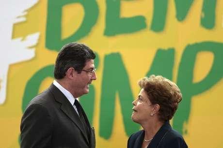 A ex-presidente Dilma Rousseff e Joaquim Levy, quando era ministro do governo petista