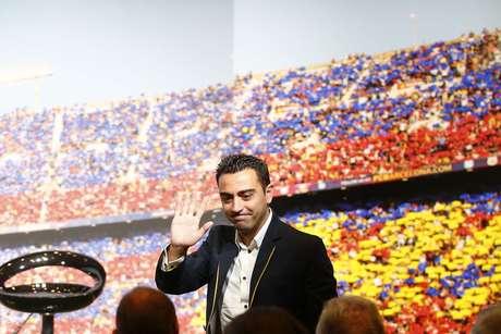 Xavi completou 24 anos de Barcelona
