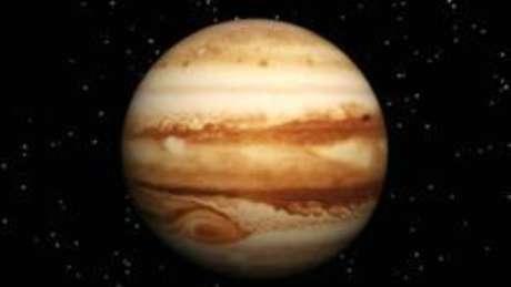 A massa do novo planeta é 'no mínimo' três vezes maior do que a de Júpiter (acima)