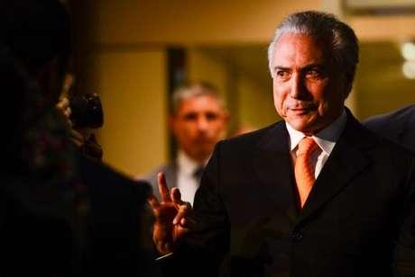 O vice-presidente Michel Temer, após reunião com a presidenta Dilma Rousseff, no Palácio do Planalto.