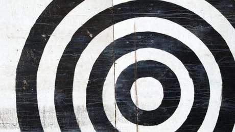 Nos primeiros designs, o código de barras era circular, como um alvo