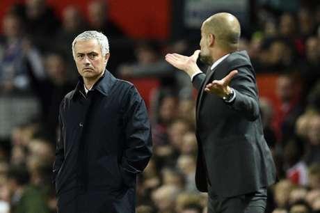 Equipes de Mourinho e Guardilam voltarão a se enfrentar no fim de abril (Foto: Oli Scarff / AFP)