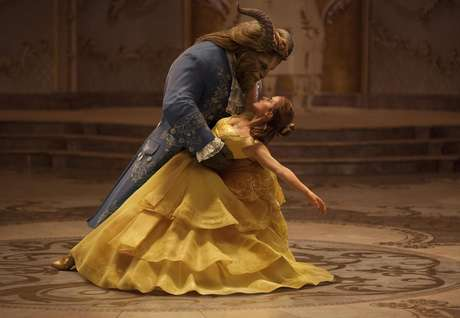 "This image released by Disney shows Dan Stevens as The Beast, left, and Emma Watson as Belle in a live-action adaptation of the animated classic ""Beauty and the Beast."""