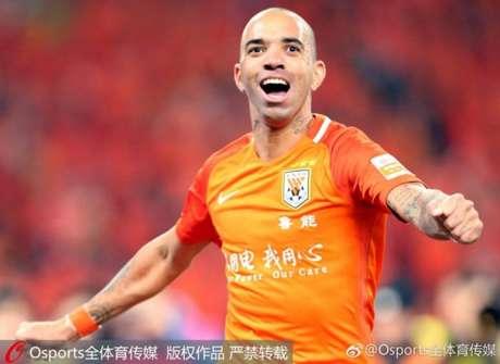Diego Tradelli marcou pelo terceiro jogo consecutivo na China (Foto: Reprodução / Sina.com)
