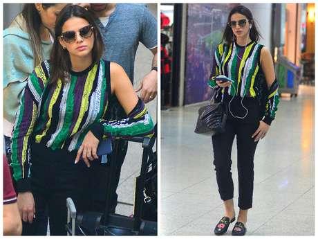 Bruna usa o calçado com blusa listrada e calça comprida