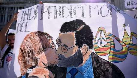 Caricatura de Rajoy e Puigdemont se beijando