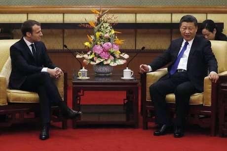 Macron vai à China e pede 'união' contra mudanças climáticas