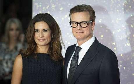 Livia Firth e seu marido em estreia de filme, em Londres