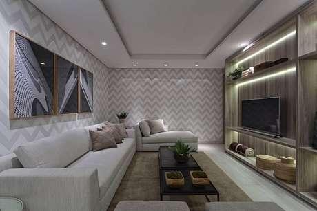 5. Deixe o papel de parede para sala com estampas grandes para ambientes mais amplos. Projeto de Renata Basques