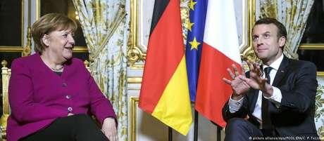 Merkel e Macron querem iniciar nova etapa na cooperação franco-alemã e preparar caminho para reforma da União Europeia
