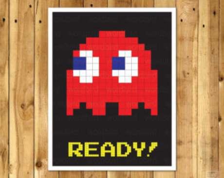 42. Quarto gamer com quadro do Blinky, de Pacman