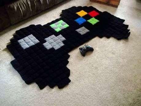 24. Quarto gamer com tapete de controle 8-bit