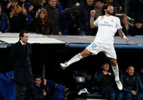 O brasileiro Marcelo comemora seu gol na vitória do Real Madrid contra o PSG 14/02/2018 REUTERS/Stringer