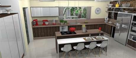 29. Espaçosa cozinha planejada com ilha