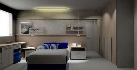 10. Quarto planejado de casal com luminárias pendentes aos lados da cama