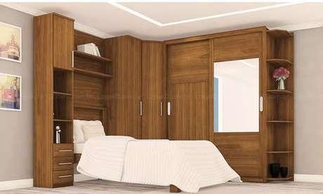 37. Os guarda-roupas planejados são também uma ótima ideia para quartos de solteiro. Projeto de LojasKD