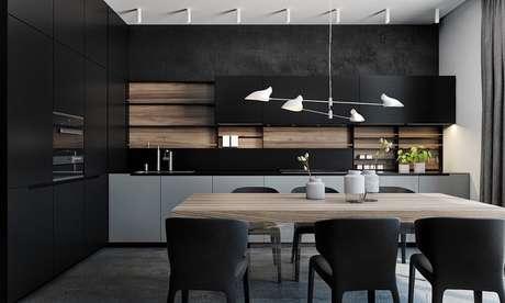 5. Cozinha planejada preta com luminária de teto bem moderna