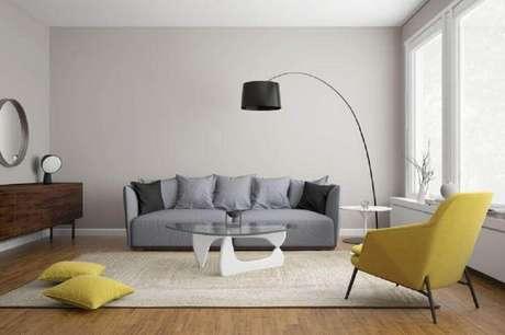 22. A decoração de sala cinza e amarelo sempre fica muito charmosa