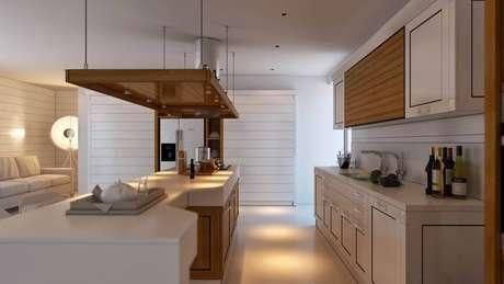 5. Linda inspiração de cozinha com coifa de ilha em tons claros e com toques de madeira.