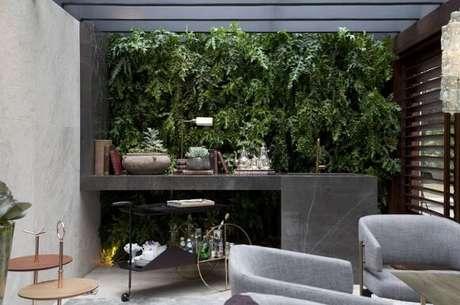 52. Agora que você sabe como fazer um jardim vertical, pode ter um como este na sua sala. Projeto de Casa Cor 2016