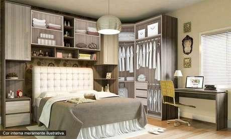 27. Modelo de armário com cama embutida para quarto de casal
