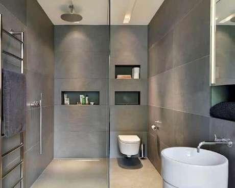 37. Modelo de banheiro pequeno e moderno