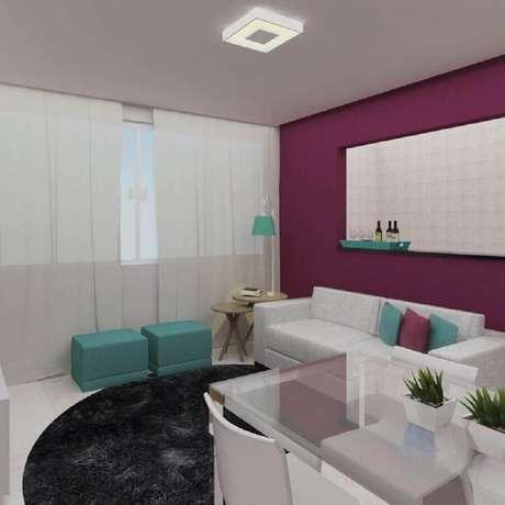 17. Decoração sala de estar pequena com puff verde água