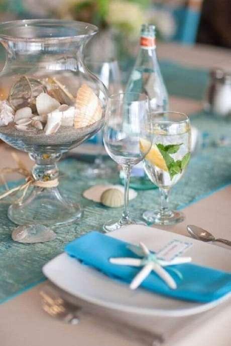 38. Utilize itens que remente à praia na decoração de casamento na praia simples