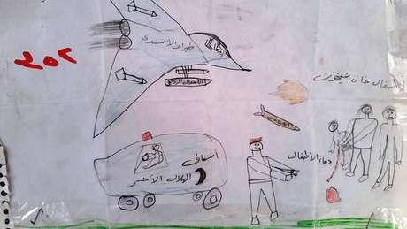 """As legendas neste desenho dizem: """"Força aérea de Assad (presidente da Síria)"""", """"ambulância"""", """"as crianças de Khan Sheikhoun"""" e """"sangue das crianças"""". Segundo a ONU, a cidade de Khan Sheikhoun foi palco, em abril de 2017, de um ataque químico promovido por forças do governo e que deixou dezenas de mortos, entre eles, várias crianças; o governo nega ter realizado o ataque."""