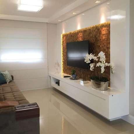Painel planejado para sala pequena com textura e iluminação ... 916546daffd2d