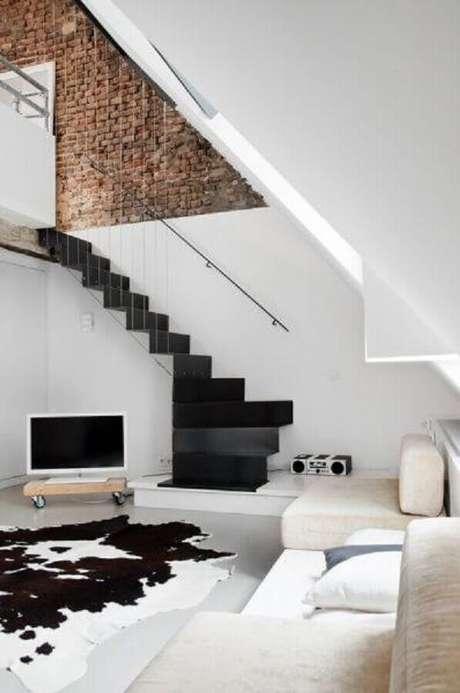 19. Decoração de casas minimalistas com parede de tijolinho
