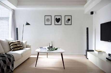 11. Aqui o minimalismo está por todas as partes, desde os móveis, a base neutra de cores e nos quadros minimalistas