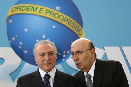 Presidente Michel Temer e pré-candidato do MDB à Presidência, Henrique Meirelles, durante cerimônia no Palácio do Planalto 23/08/2018 REUTERS/Adriano Machado