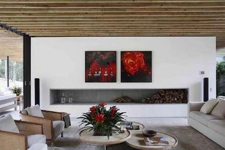 30. Lareiras ajudam a compor a decoração dos ambientes de um lar