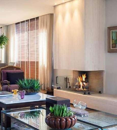49. As lareiras com revestimento de vidro são perfeitas para ambientes mais modernos