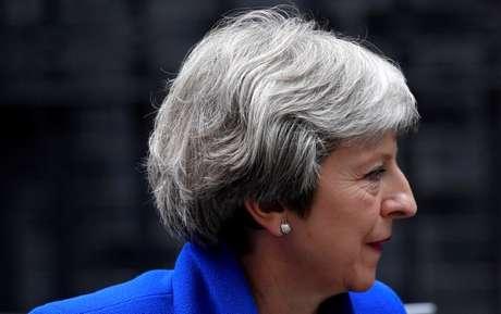 Primeira-ministra britânica, Theresa May, chega em Downing Street depois de obter uma vitória em votação sobre o Brexit no Parlamento 20/06/2018 REUTERS/Toby Melville