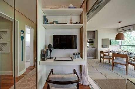 23. A mesa fixa na parede economiza espaço e fica bem moderna no ambiente
