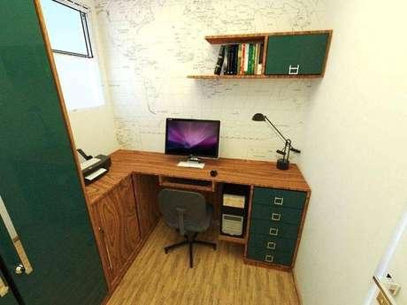 34. Mesa de canto para computador feita de madeira e com gaveta pintadas de verde
