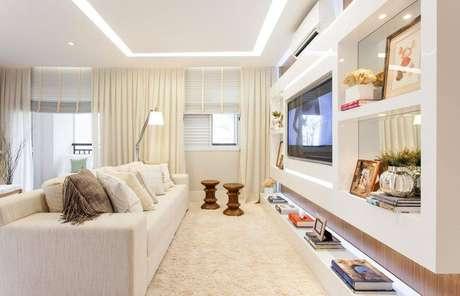 29. Decoração clean para sala com nichos embutidos