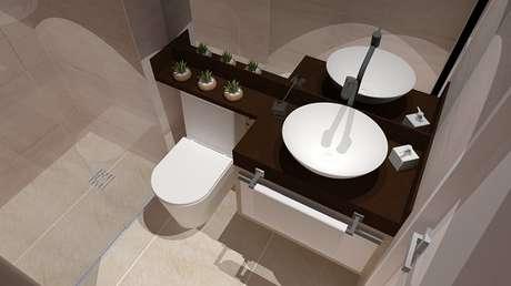 16 -Banheiro com bancada em granito marrom absoluto e cuba de sobrepor na cor branca.