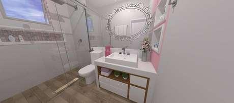 6. O armário com detalhes em madeira deixa o banheiro mais aconchegante
