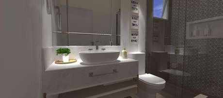 49. Os armários de banheiro planejados podem ganhar iluminação diferente para um efeito interessante. Projeto por Raquel Venezian