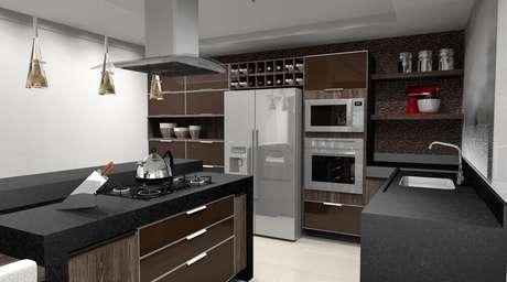 21. Cozinha planejada decorada com nichos embutidos e planejados para receber adega, forno e microondas