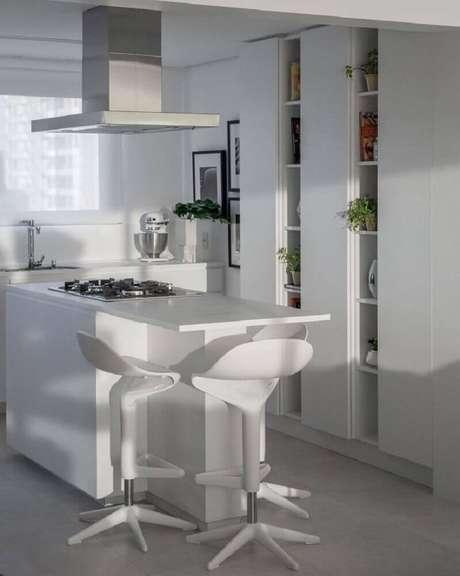25. Decoração toda branca com nichos decorativos para cozinha planejada