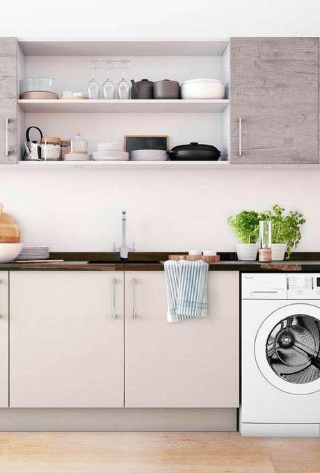 30. A cozinha integrada à lavanderia também pode receber nichos organizadores