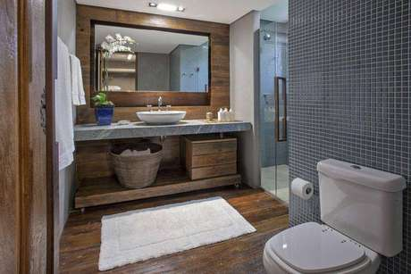 29. Para um banheiro mais rústico utilize piso de madeira